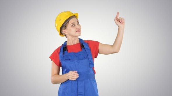 Thumbnail for Young smiling Worker woman pointing on imaginary buttons