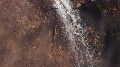 Autumn waterfall at sunset