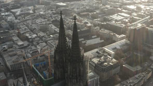 Thumbnail for AERIAL: Close Up Circling Around Cologne Cathedral in Beautiful Hazy Sunlight with Rain