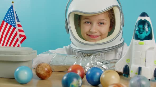 Little Girl 89 Years Old in an Astronaut Costume Smiling Happy Child Looking at the Camera Closeup