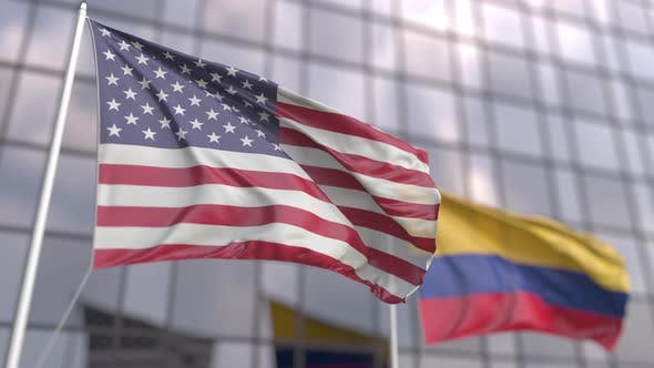 Waving Flags of the United States and Colombia