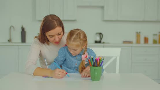 Thumbnail for Positive Mum and Daughter Drawing Picture Together