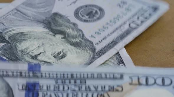 Rotating stock footage shot of $100 bills - MONEY 0134