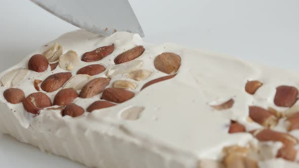 Thumbnail for Cutting nougat halva with knife 4K  footage