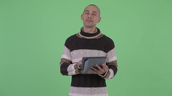 Thumbnail for Happy Bald Multi Ethnic Man Thinking While Using Digital Tablet
