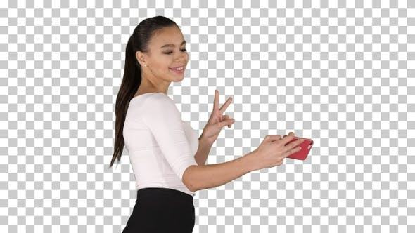 Thumbnail for Young brunette taking selfie photo on smartphone smiling joyful