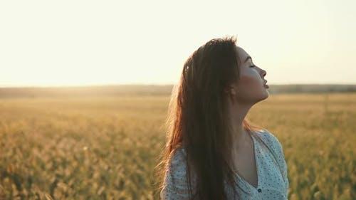 Lovely Girl in Open Field.
