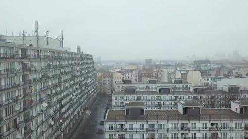 Big Grey Apartment Complex Ghetto Block Building in Foggy Cityscape of Berlin Kreuzberg in Germany