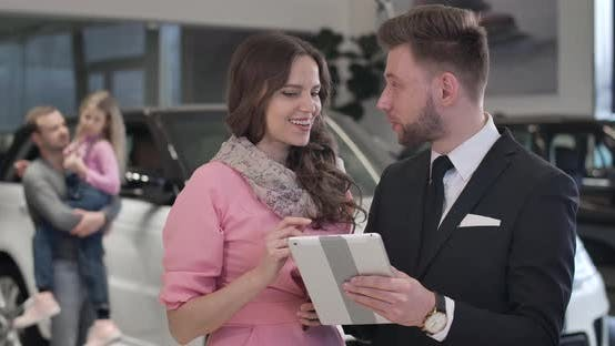 Thumbnail for Close-up of Beautiful Caucasian Woman Discussing Car Purchase with Trader