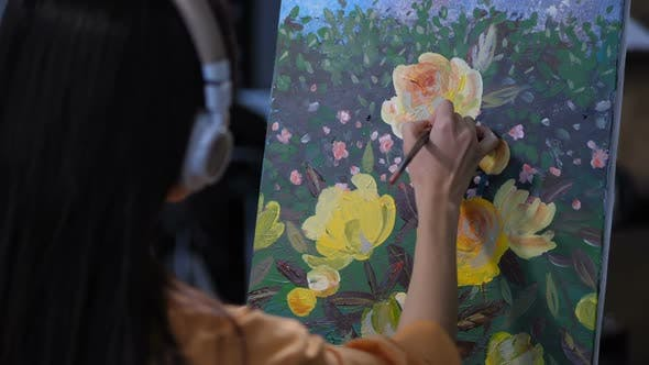 Woman Painter in Headphones Drawing Nature