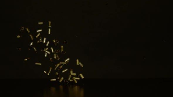 Thumbnail for Falling bullet shells, Ultra Slow Motion