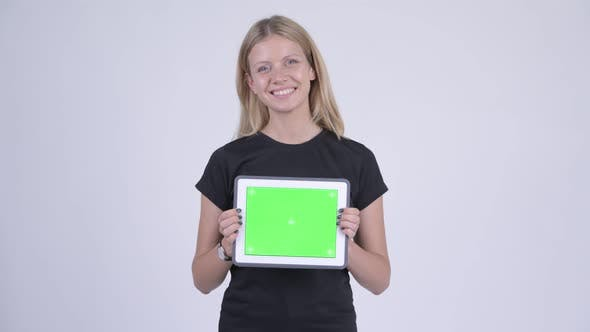 Cover Image for Young Happy Blonde Woman Showing Digital Tablet