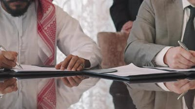 Unrecognizable Political Representatives Signing Agreement