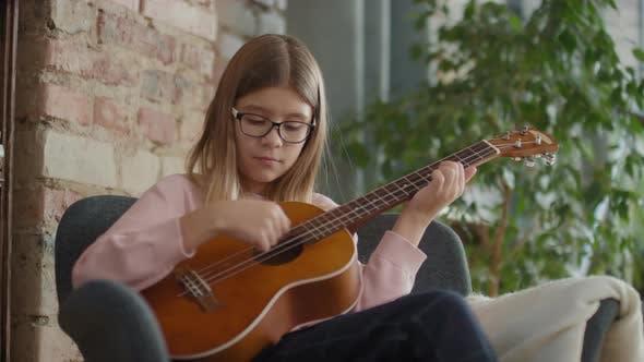 12-Year-Old Girl Playing Ukulele