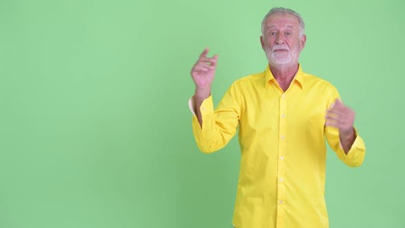 Thumbnail for Happy Senior Bearded Businessman Touching Something and Looking Surprised