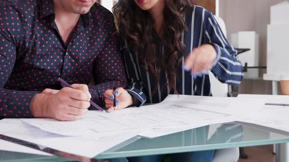 Thumbnail for Close Up of Architects Drawing on Blueprints in the Office