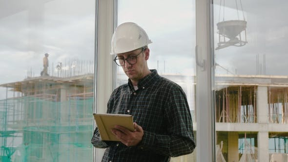 Thumbnail for Engineer Working on Tablet in Hand on Construction Site