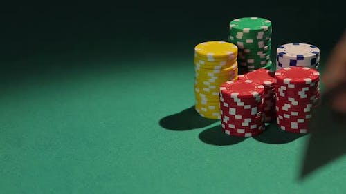 Professional Poker Player Showing Pair of Aces to Rival, Casino Chips on Table