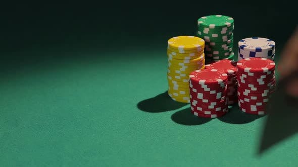 Thumbnail for Professional Poker Player Showing Pair of Aces to Rival, Casino Chips on Table