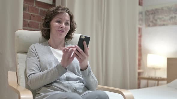 Thumbnail for Attractive Old Woman Using Smartphone in Bedroom