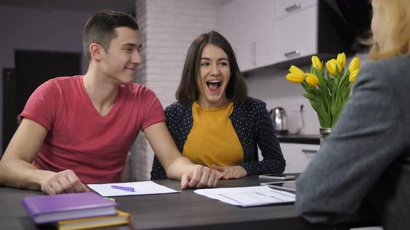 Thumbnail for Cheerful Couple Signing Contract with Estate Agent