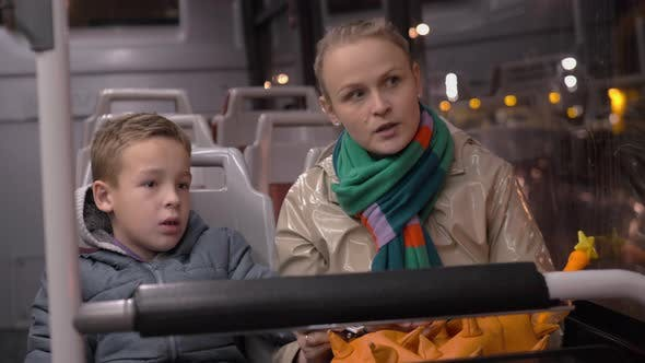 Mum and Son Talking When Traveling By Bus in the Evening
