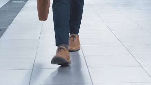 Low Section Of Businessman Walking