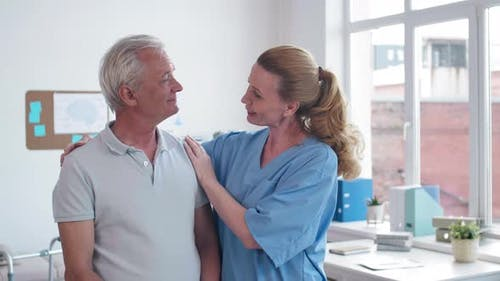 Portrait of Physiotherapist with Patient