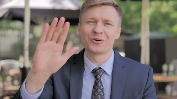 Thumbnail for Hello, Welcoming Businessman Waving Hand