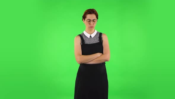 Thumbnail for Funny Girl in Round Glasses Is Very Offended and Looking Away Then Smiling and Rejoicing. Green