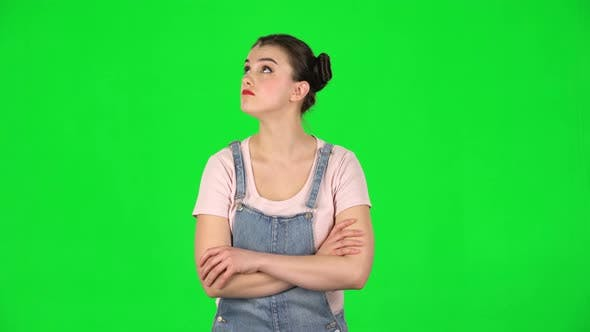 Thumbnail for Lovely Girl Listens Carefully To Boring Information and Looks Around on Green Screen