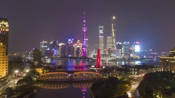 Shanghai Skyline at Night. Lujiazui District, Huangpu River and Waibaidu Bridge. China. Aerial View