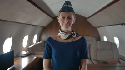Portrait of Young Air Hostess Inside of Private Jet Cabin.