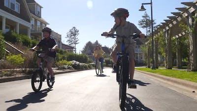 Family riding bikes in coastal community