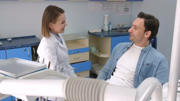 Thumbnail for Female Dentist Greeting Male Patient at Clinic