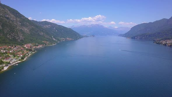 Cover Image for Aerial view drone flies over beautiful mountain lake Como in Italy, sunny weather