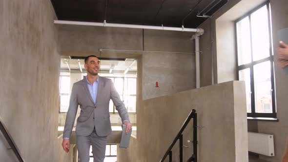 Thumbnail for Businessman Meeting Businesswoman at Office Stairs