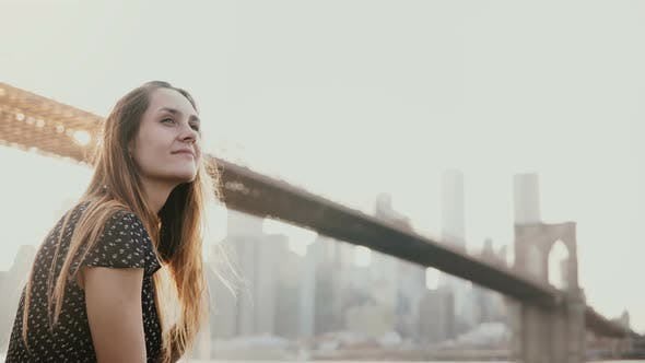 Thumbnail for Happy Smiling European Young Woman Smiling, Enjoying Amazing Sunset View of New York Near Brooklyn