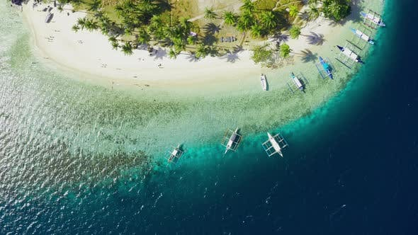 Thumbnail for Boats Moored at Paradise Tropical Ipil Beach on Pinagbuyutan Island with Azure Turquoise Sea in El