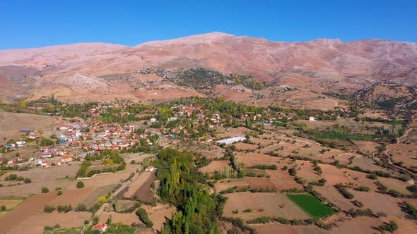 Scenic Aerial View of Mountain Valley with Agricultural Fields
