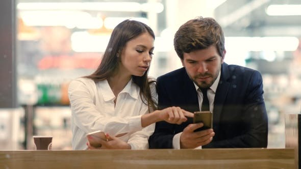Thumbnail for Technology and people concept - business couple with smartphones
