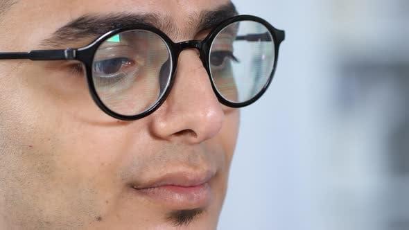 Thumbnail for Middle Eastern Man Reading Data on Smart Glasses
