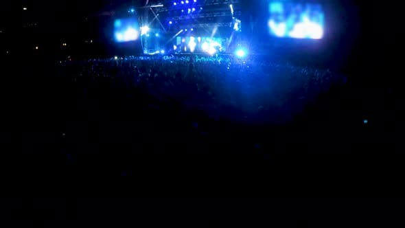 Thumbnail for Stage Floodlights Blinking Over Thousands of People Standing in Front, Concert
