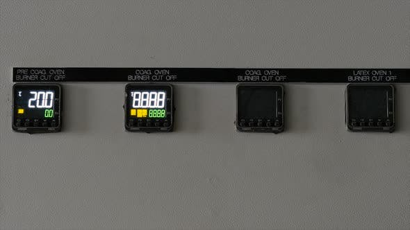 Sensors on the Device Light Up. Enabling Equipment Sensors at the Factory. Close-up.