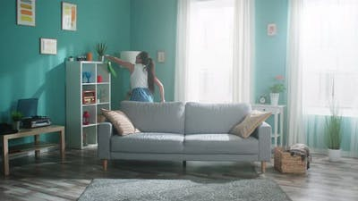 Woman Is Dancing and Cleaning Living Room