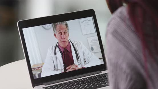 Thumbnail for Woman talking to senior doctor on her laptop