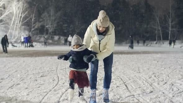 Thumbnail for Little Girl Practicing Ice Skating with Mother