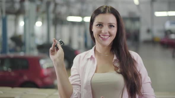 Thumbnail for Portrait of Satisfied Caucasian Woman Showing Car Keys and Smiling