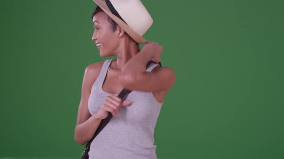 African American young woman looking at the camera on green screen