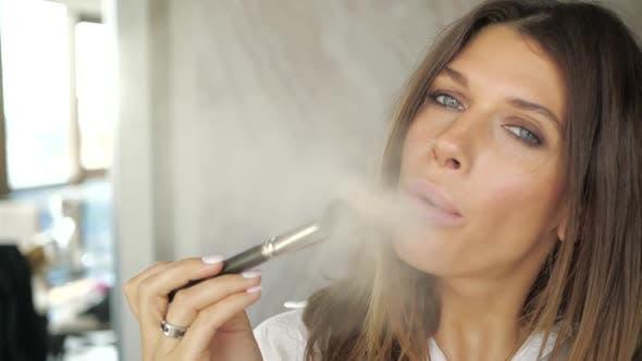Attractive Girl Sensually Blows Powder From a Makeup Brush